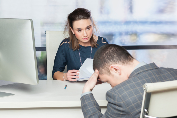 Human resources consultant talking with depressed employee